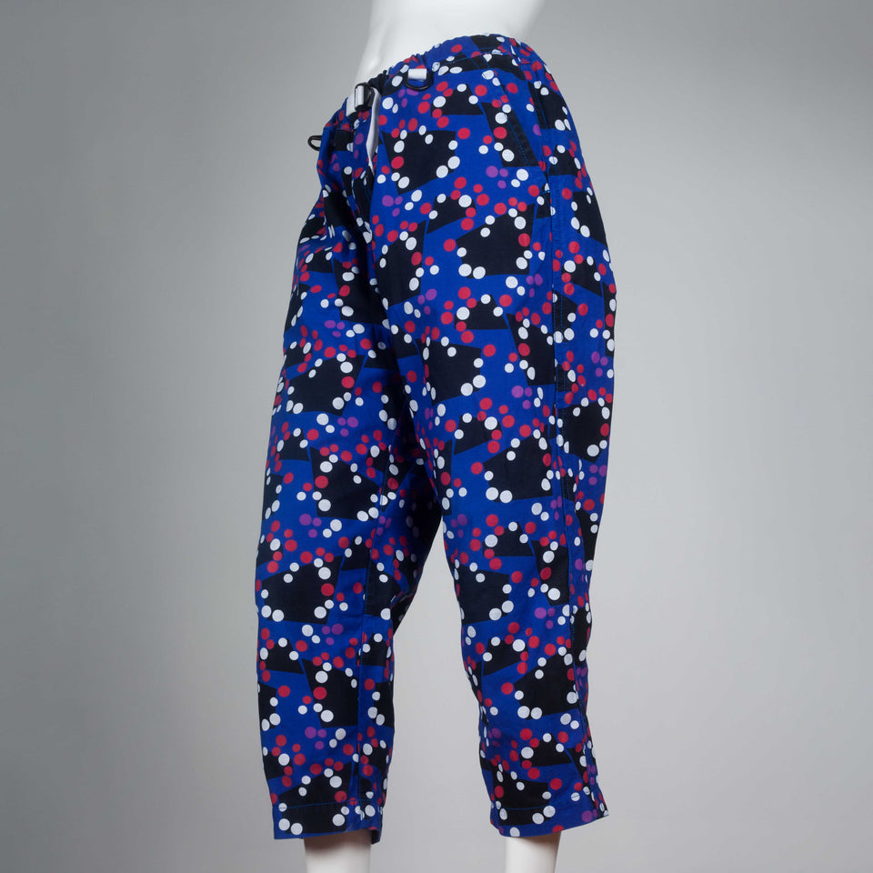 Comme des Garçons Ganryu 2012 trousers in blue with black geometric pattern, and red and white dots.