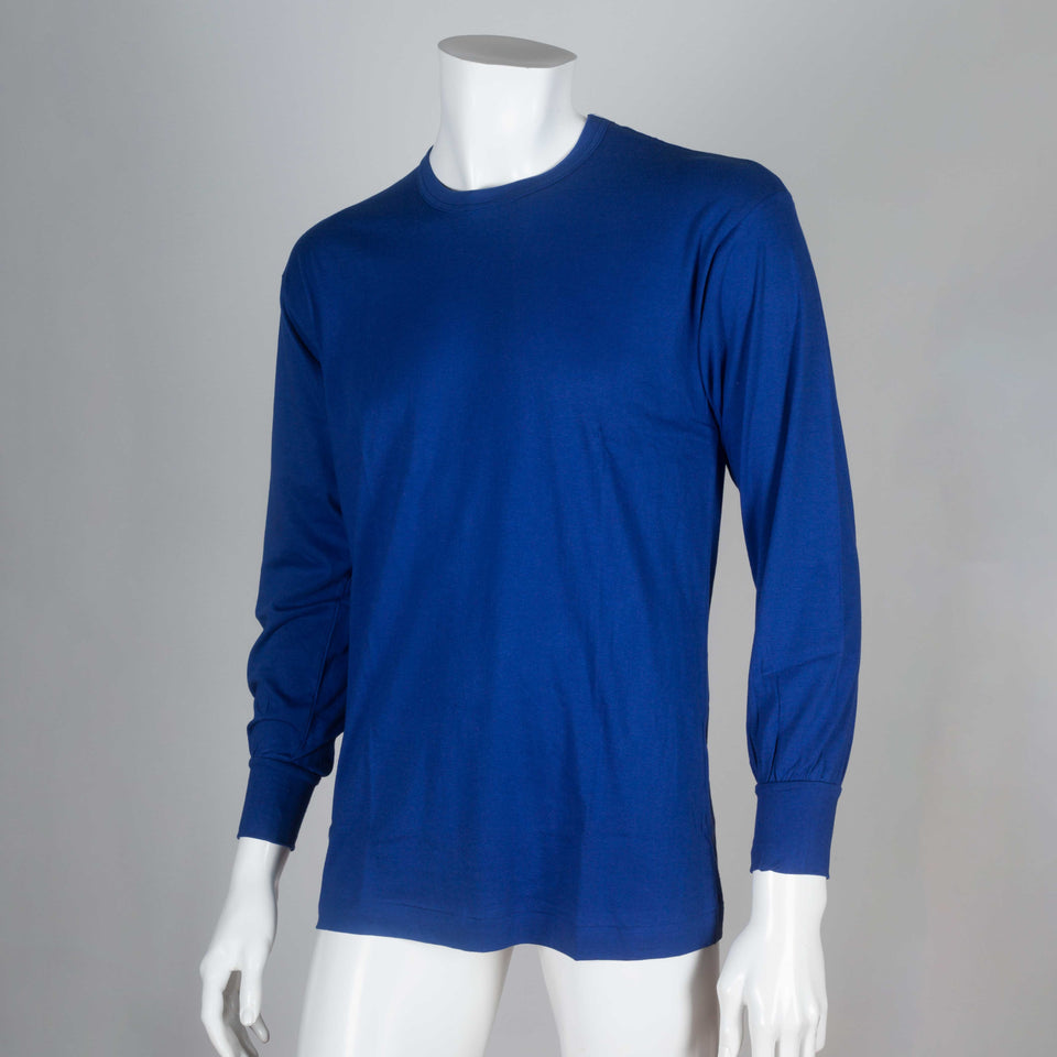 "Vibrant blue cotton long-sleeve jersey tee from Japan with text ""1989 Comme des Garçons HOMME"" on back."