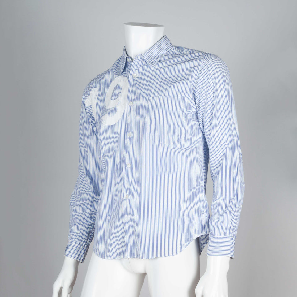 Comme des Garçons 2005 long sleeve poplin shirt with blue and white pinstripes and screen printed number 19.