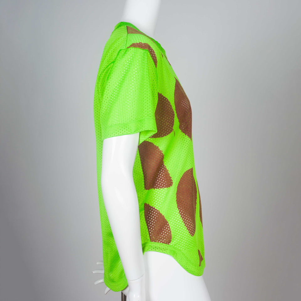 Comme des Garçons tee in neon green mesh from Japan with sienna screen-printed leaves.