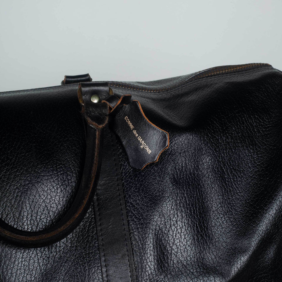 Comme des Garçons large, black leather Boston bag from Japan.