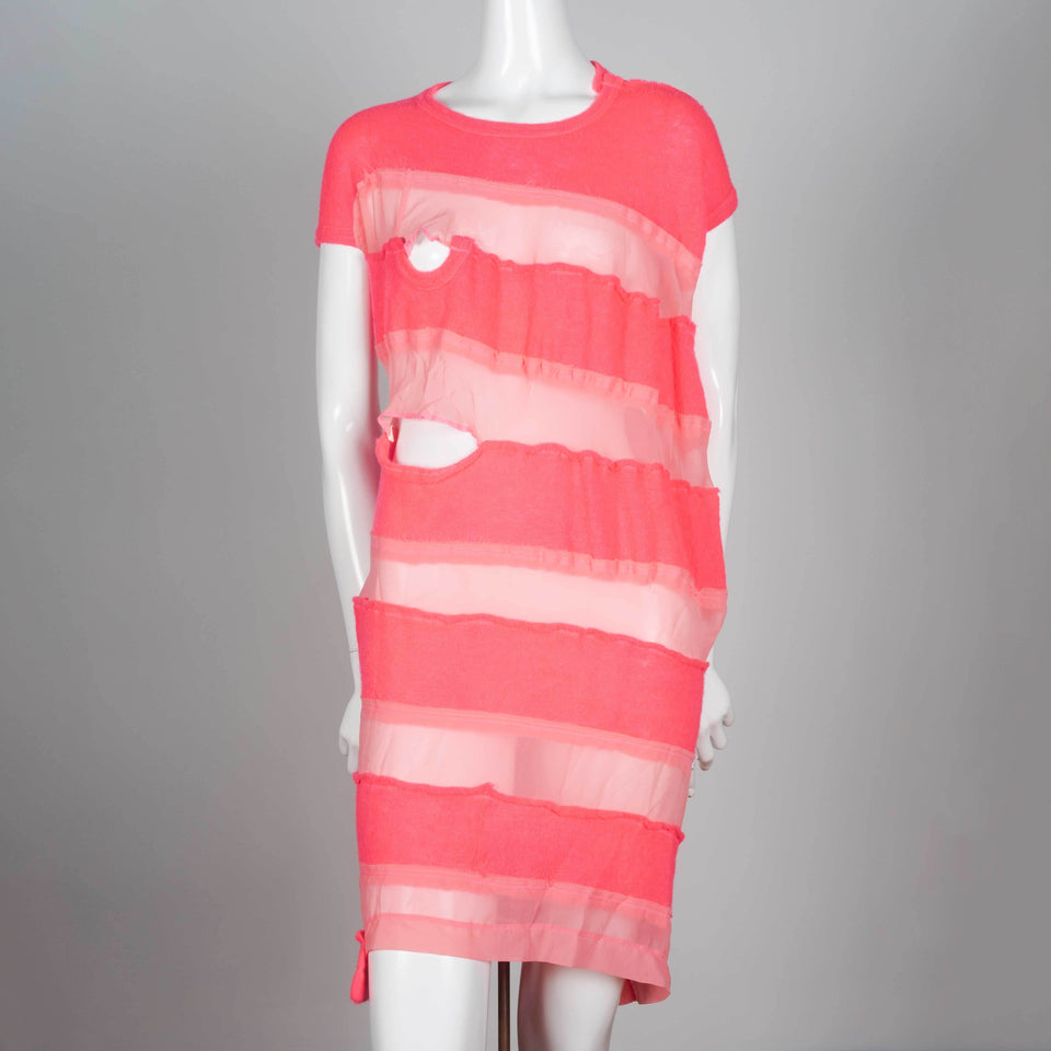 Comme des Garçons Tricot 2013, a neon pink sweater dress with alternating sheer horizontal strips.