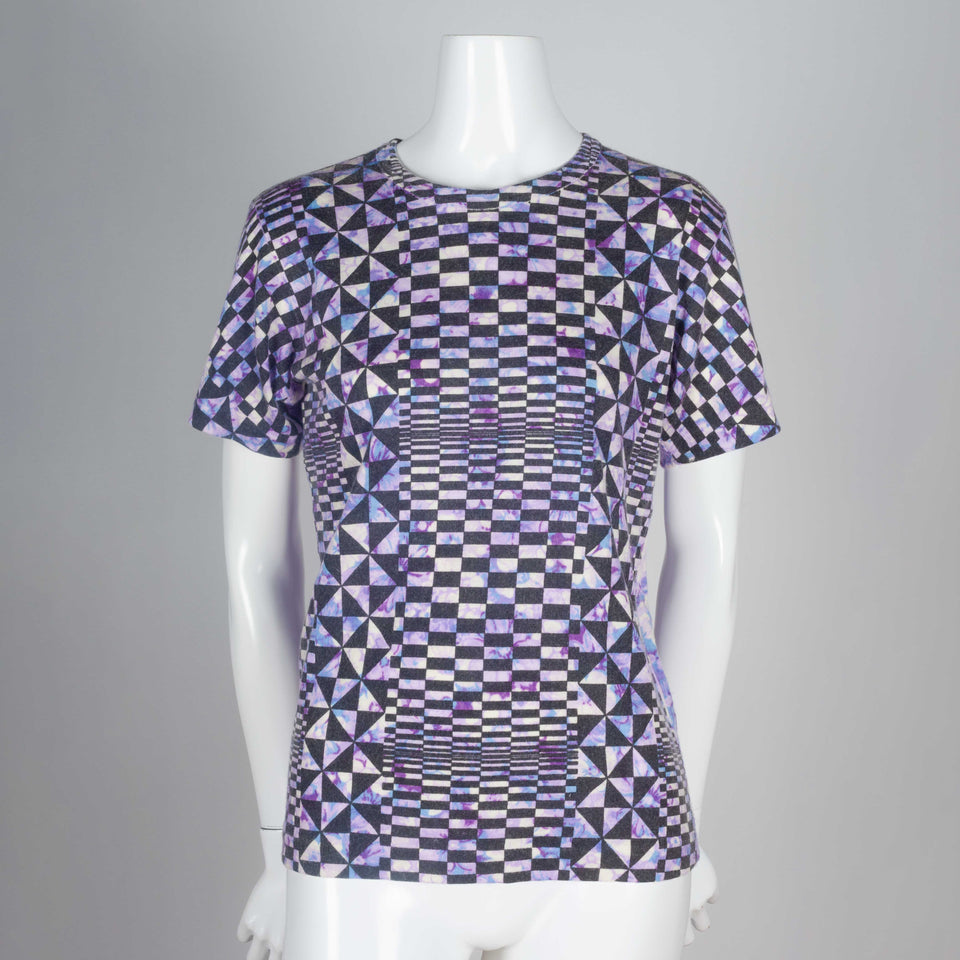 A purple vintage Comme des Garçons floral t-shirt with black geometrical pattern screen printed on the front.