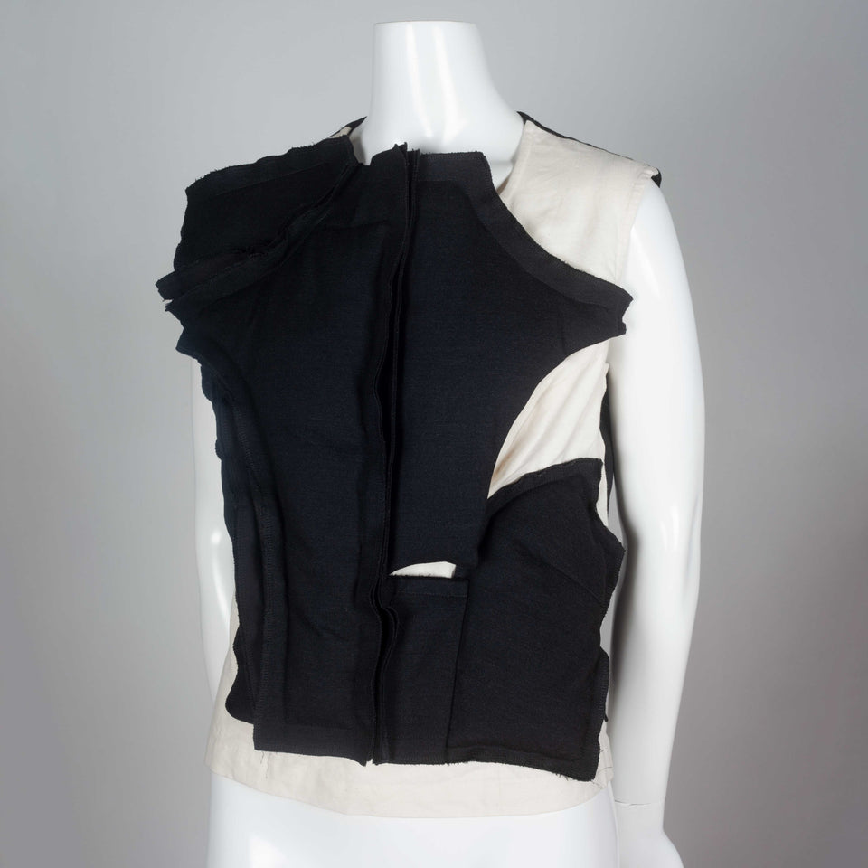 Comme des Garçons 2010 sleeveless shirt with asymmetrically padded front.