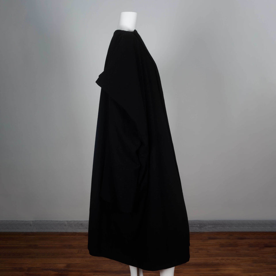 Comme des Garçons 1996 black wool wrap dress from Japan cut in a square with three quarter sleeves and an oversized cape style.