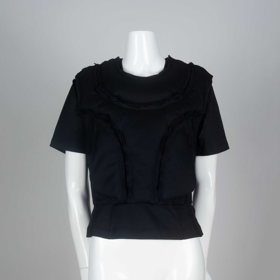Comme des Garçons 2010 black wool top with padding on chest around collar and on torso.