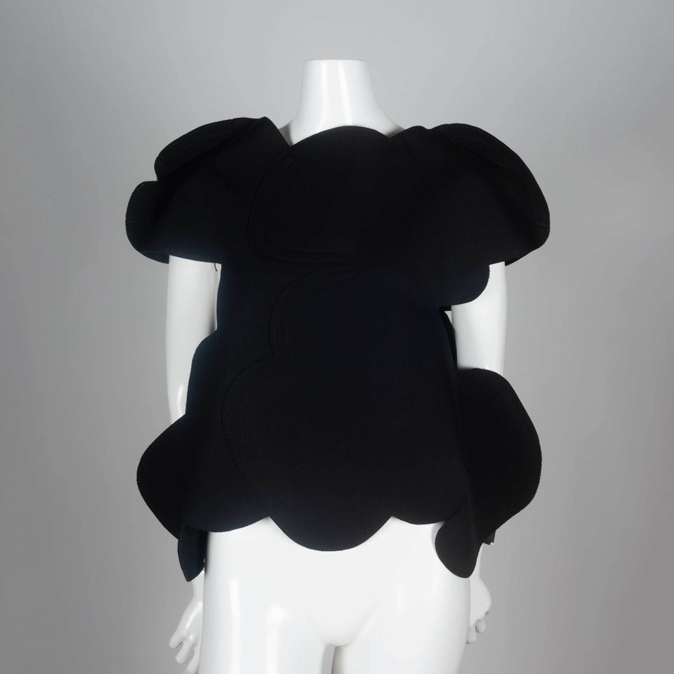 Comme des Garçons 2012 black wool shirt with an organic cloud shape and open sides under arms.