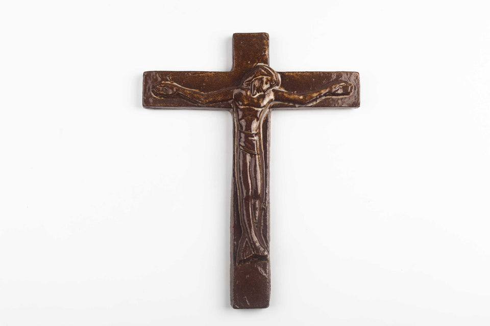 Belgian wall cross in ceramic, hand-painted in semi-gloss earthy brown with abstract Christ figure in volume.