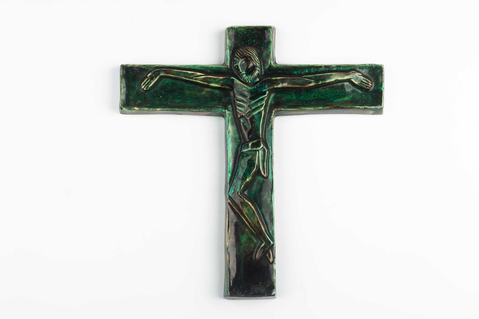 Midcentury European wall crucifix in glazed, hand-painted green ceramic.