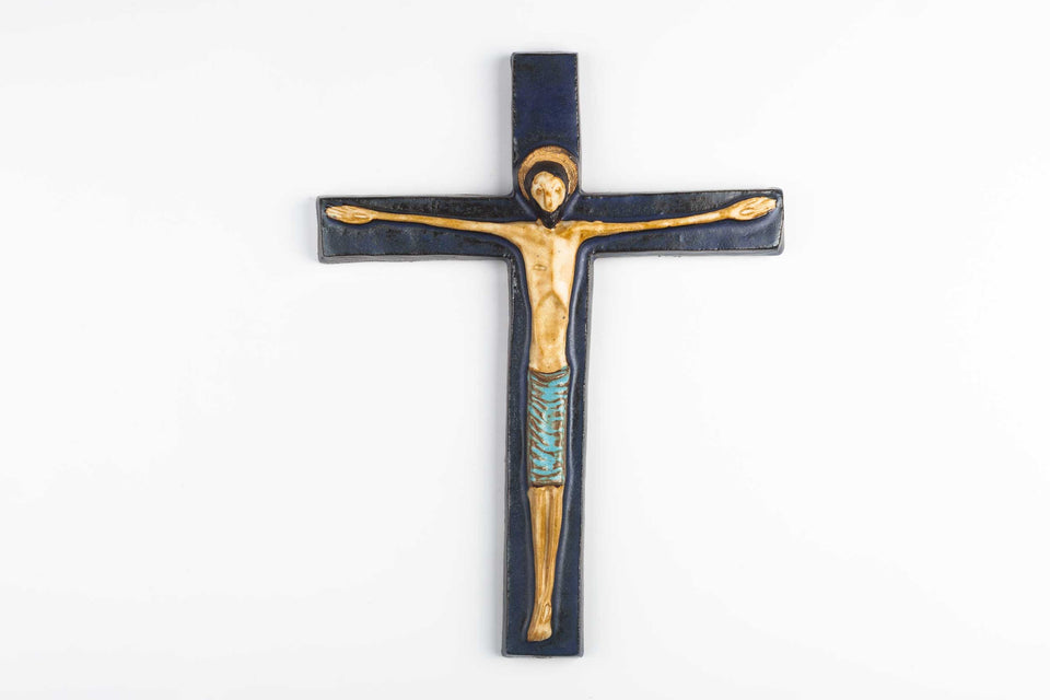 Vintage European wall cross in dark and light blue hand-painted ceramic.