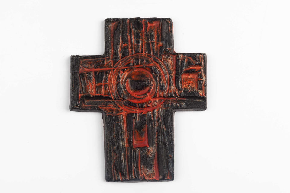 Midcentury European wall cross in dark brown and orange textured and glazed ceramic.