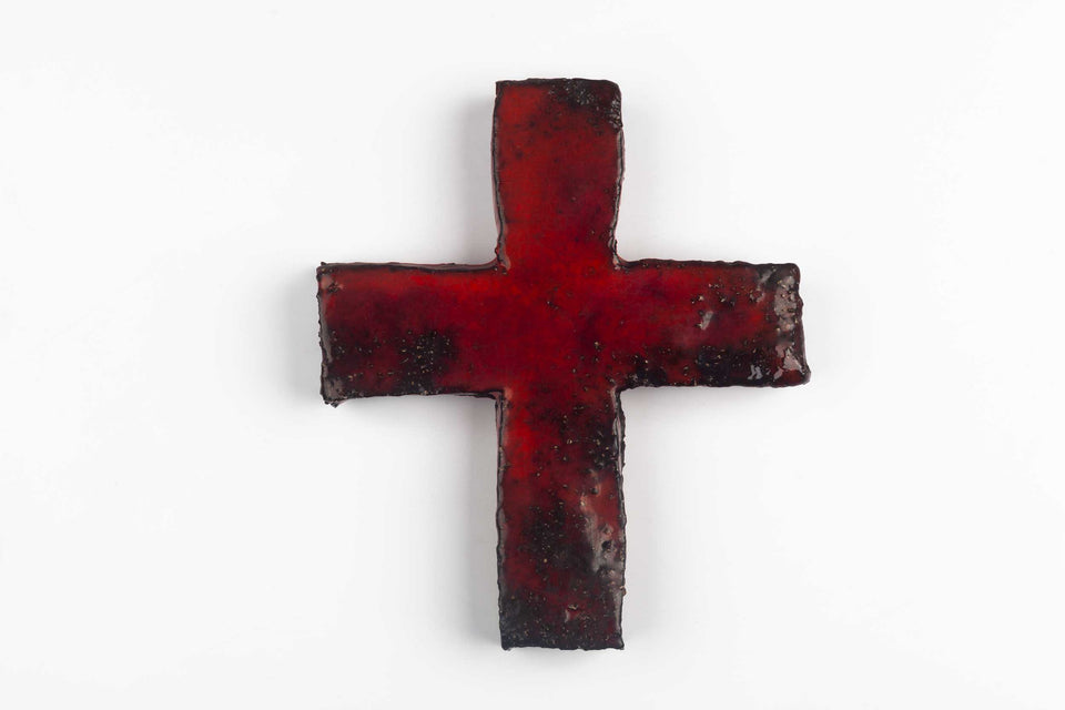 Midcentury European wall cross in textured ceramic, hand painted in red and black with glossy glaze.