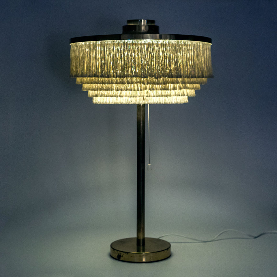 Large brass and silk fringe table lamp designed by Hans-Agne Jakobsson in 1965.