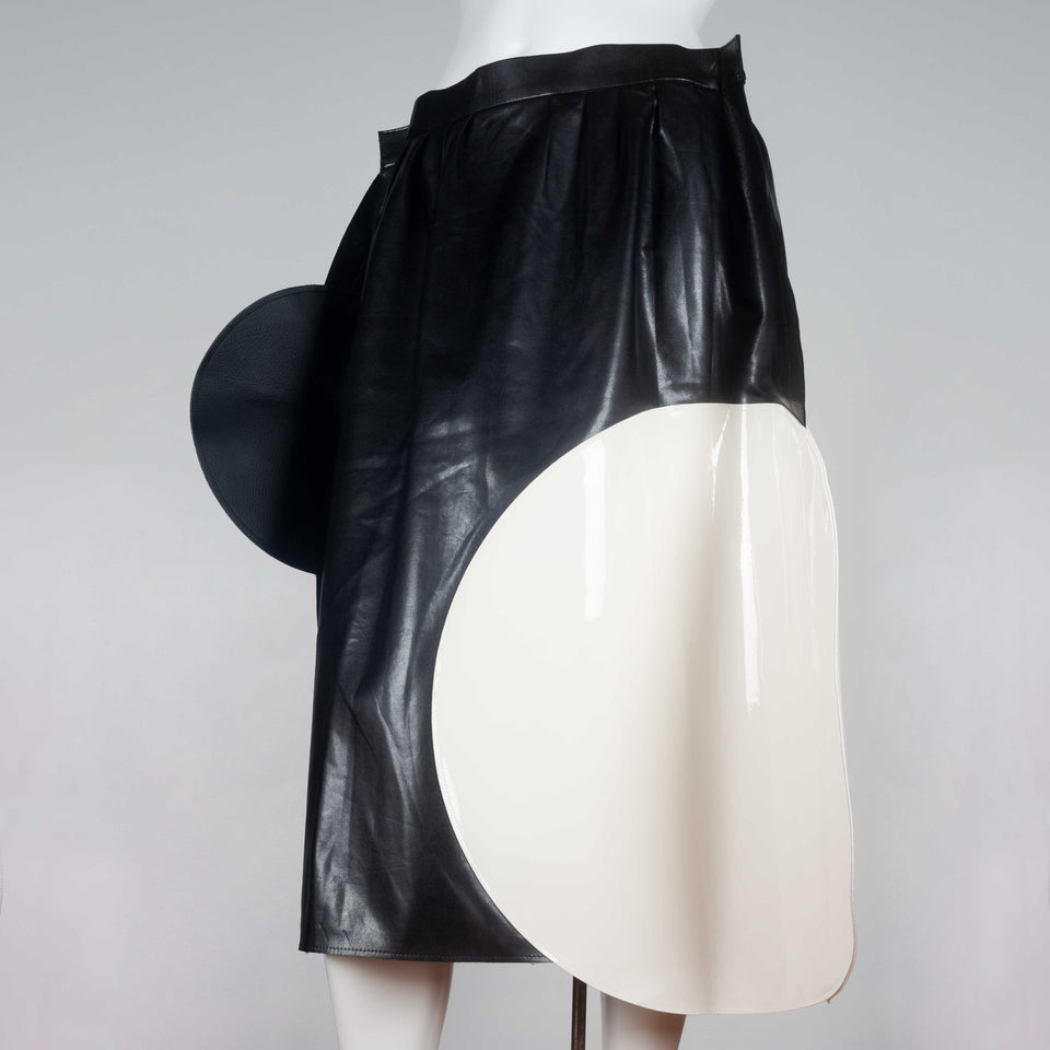 Junya Watanabe x Comme des Garçons 2014 faux leather skirt from Japan embellished with white and black circles.