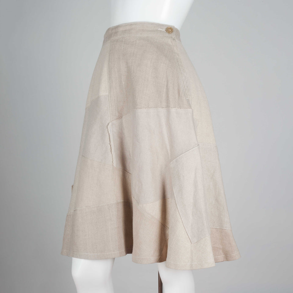 Junya Watanabe x Comme des Garçons 2013, a patchwork skirt from Japan composed of neutral tones in patchwork linen and an A-line cut.