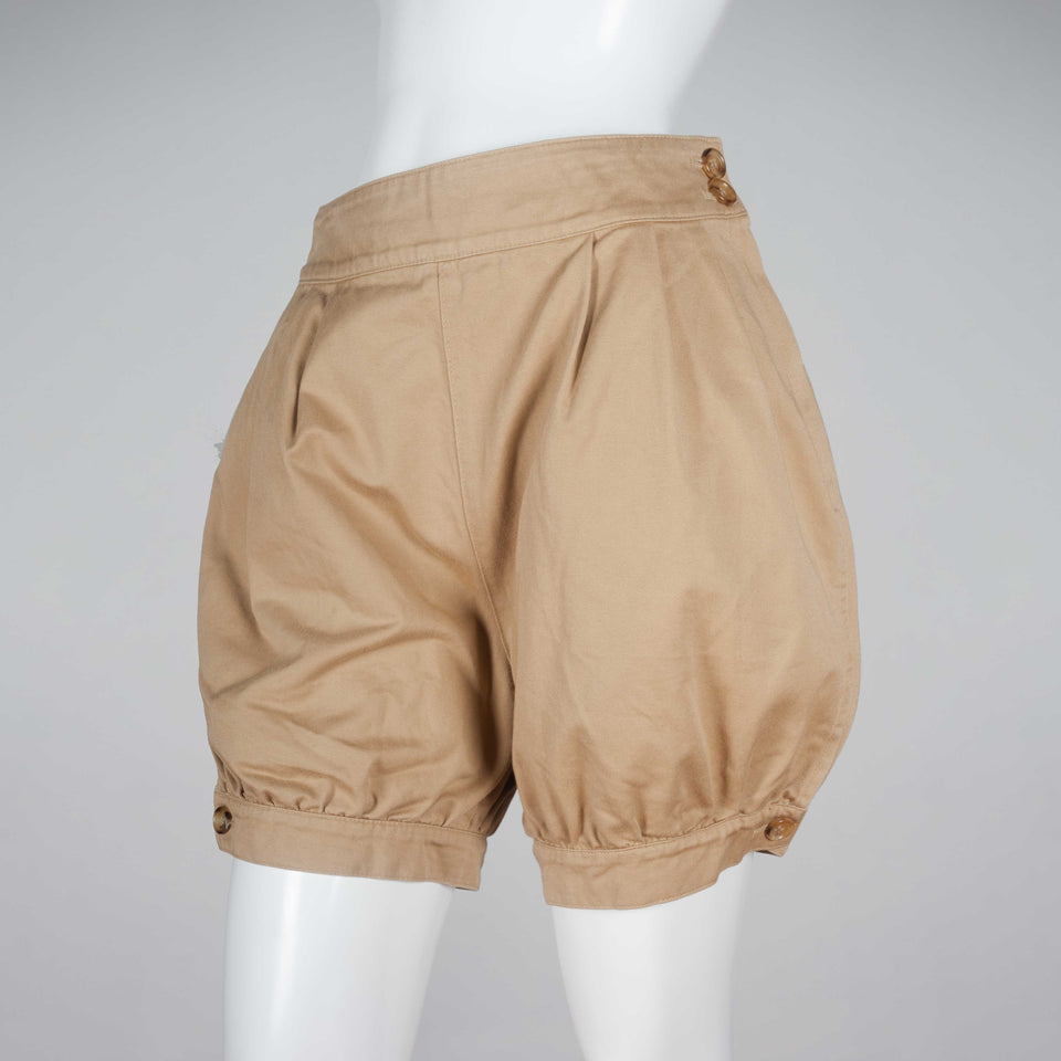 Junya Watanabe x Comme des Garçons, beige shorts from Japan with tapered, button hem and a ballooning fit to the fabric around hips and thighs.