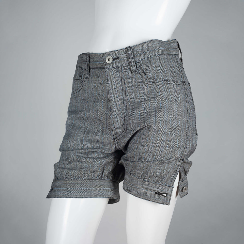 Junya Watanabe x Comme des Garçons 2007, gray wool shorts with pin stripe pattern, dark stitching and tapered, button hem.