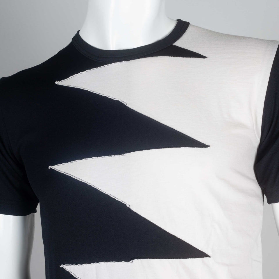 Comme des Garçons black and off-white jersey tee with a lighting bolt zig zag design of interwoven fabric on chest.