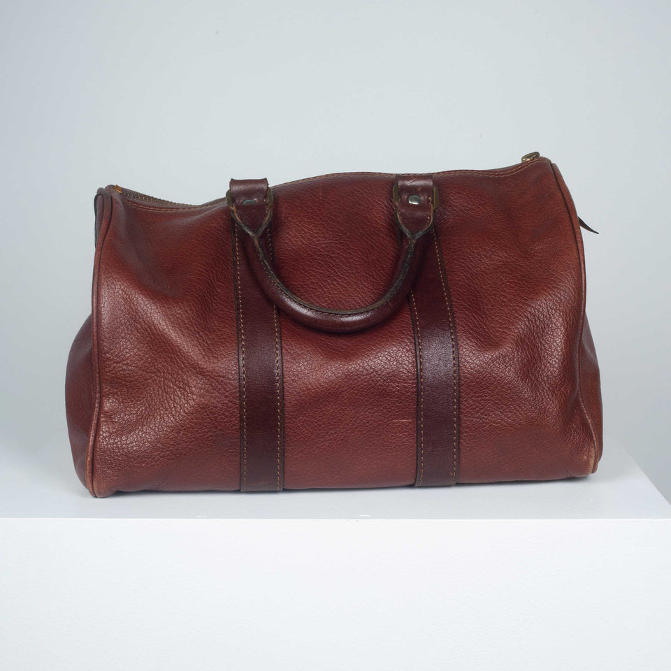 Comme des Garçons small, brown and burnt sienna leather Boston bag from Japan.