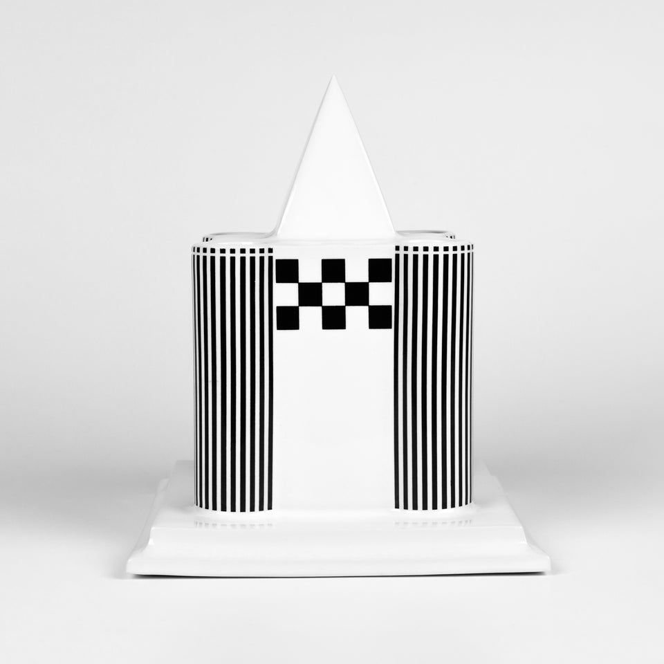 Candle holder in the shape of a Viennese castle in glazed porcelain with black and white painted graphics.