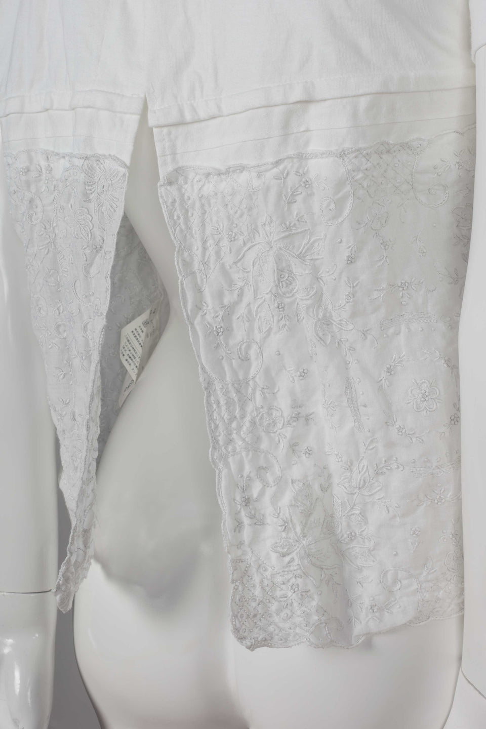 Comme des Garçons Tao, a white cotton t-shirt with embroidered linen lower that looks like lace.
