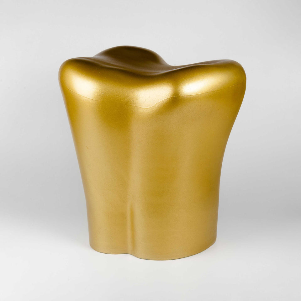 Gold tooth stool by Philippe Starck at PHX Gallery Chicago.