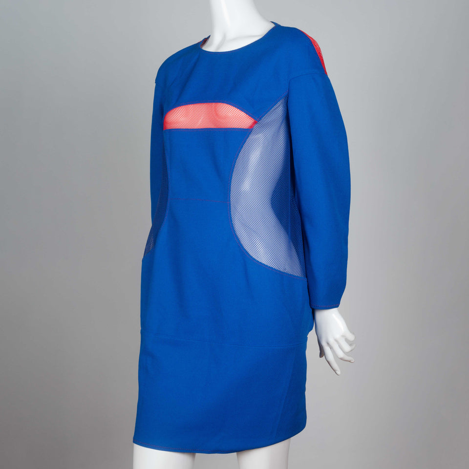 Junya Watanabe x Comme des Garçons 2012 blue three quarter sleeve, knee length dress with pink mesh covered cut-outs.
