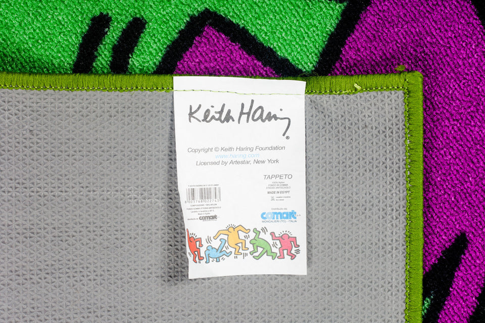 Keith Haring rug tag with Comart, Artestar and Keith Haring Foundation logos.