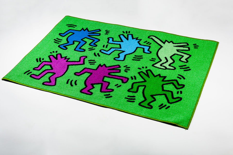 Keith Haring green rug with colorful dancing figures.