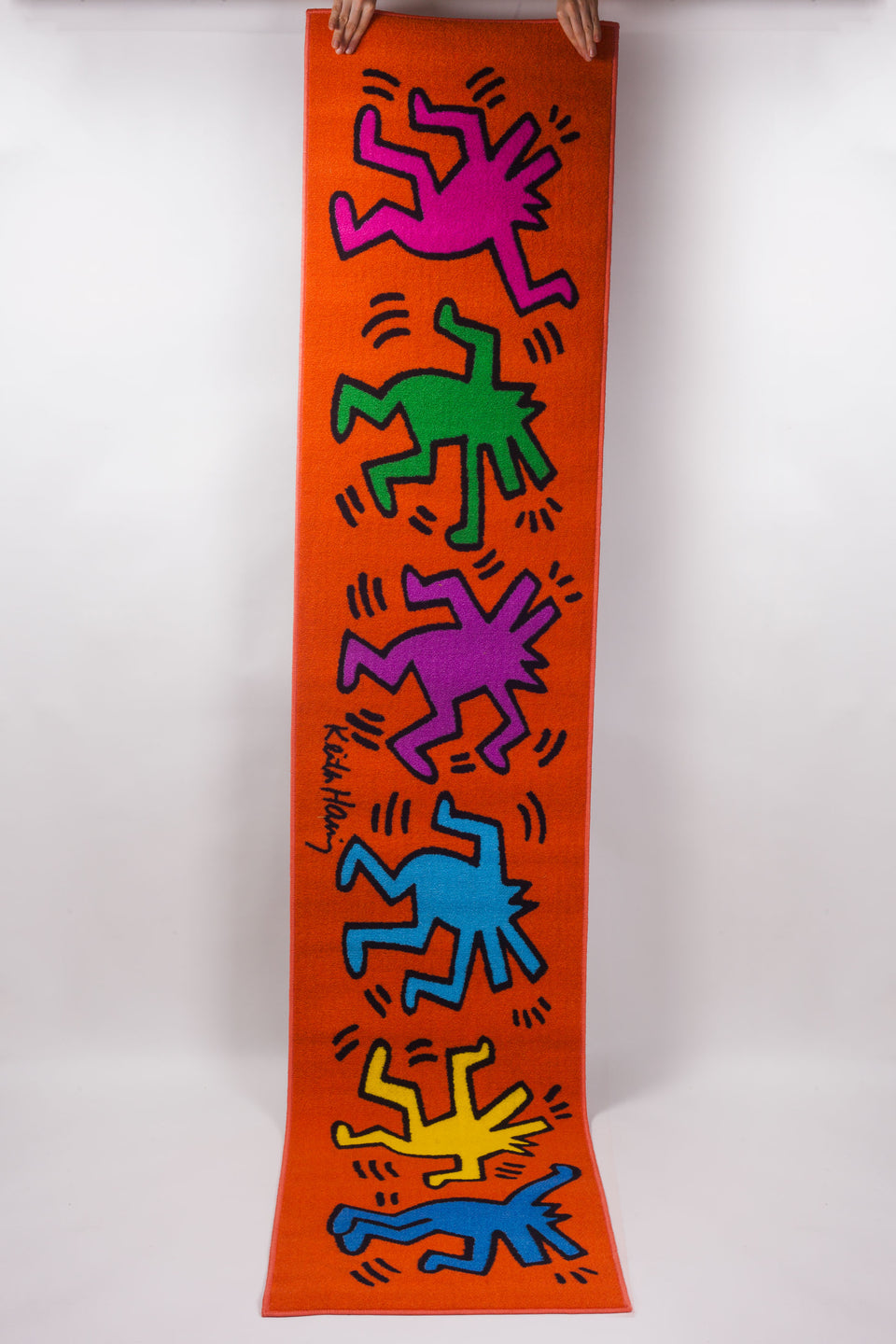 Brilliant colors in this Keith Haring runner with dancing figures, distributed by Comart Italia.