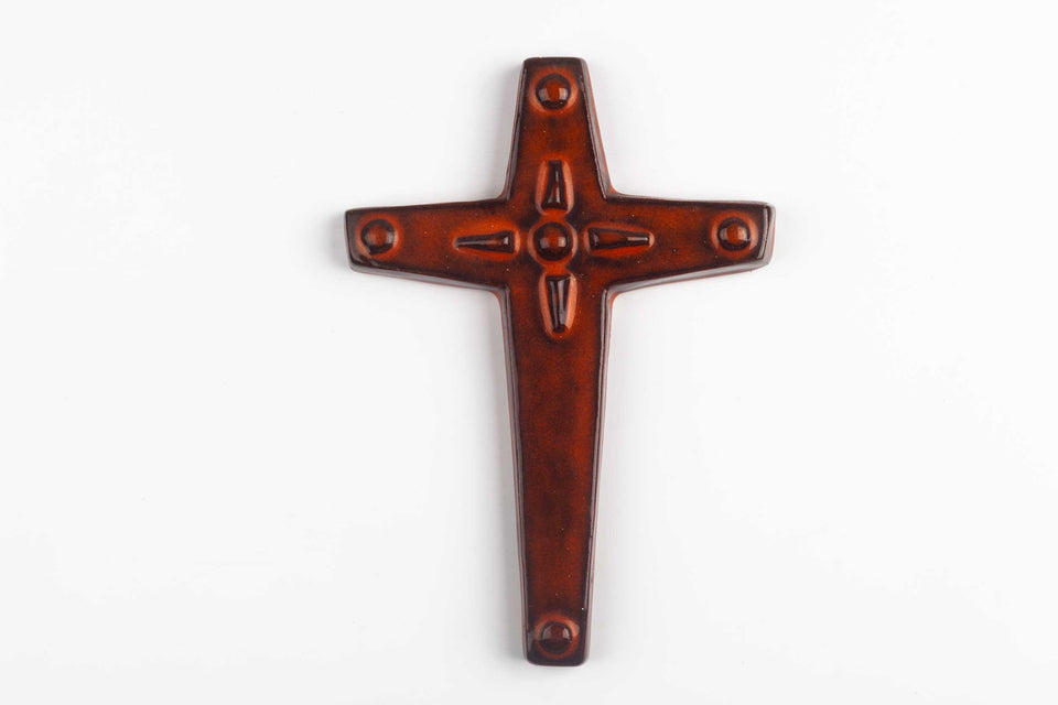 Midcentury European wall cross in glazed, hand painted ceramic with decorative volume.