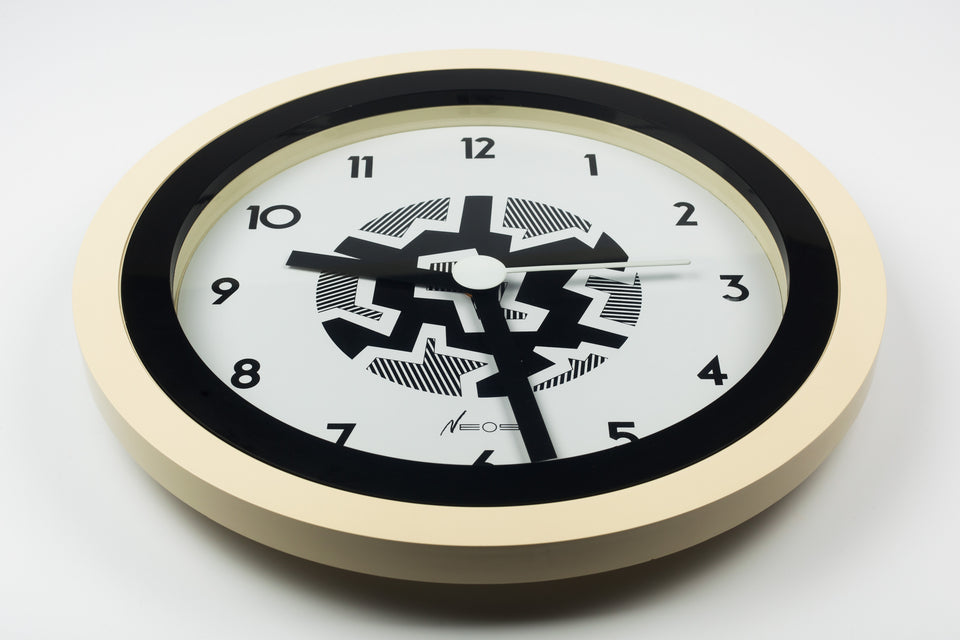 Postmodern wall clock designed by the Memphis Group founding members and couple, George Sowden and Nathalie du Pasquier.