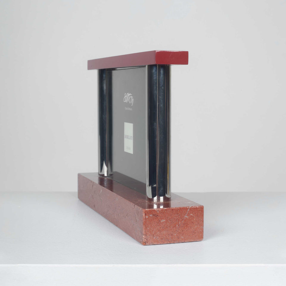 Picture frame in red marble by Italian designer, Ettore Sottsass.