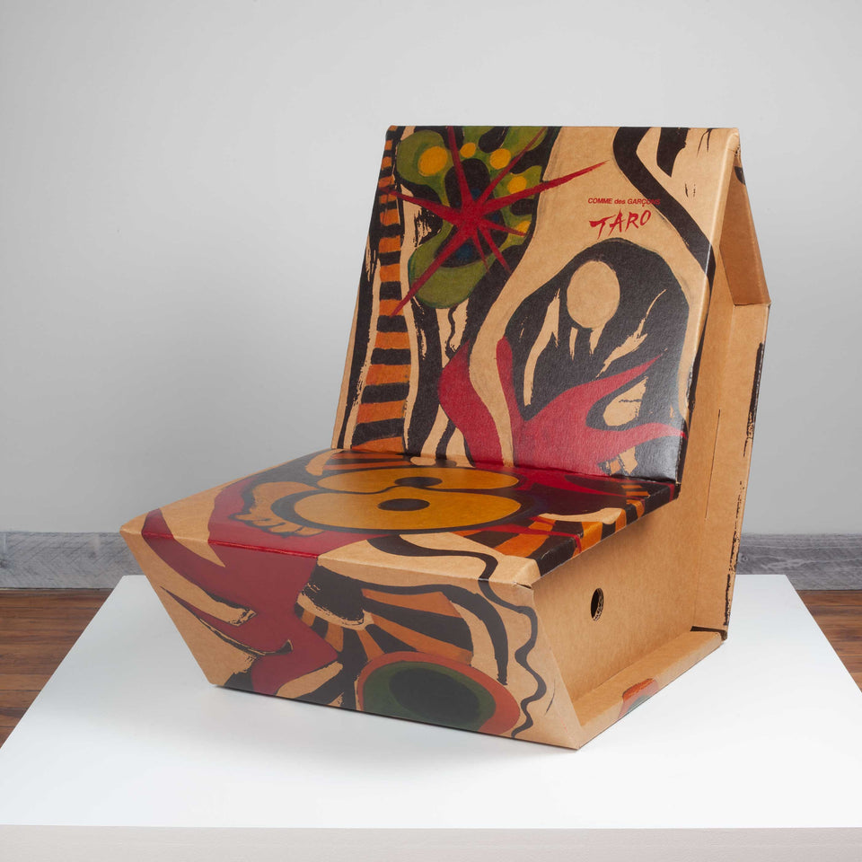 Cardboard chair with Taro Okamoto illustration, released in Japan by Comme des Garçons in 2011.