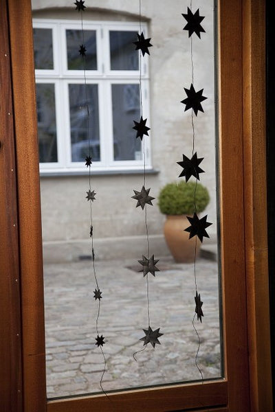 Black garland with 9 flat folded stars on a black string S
