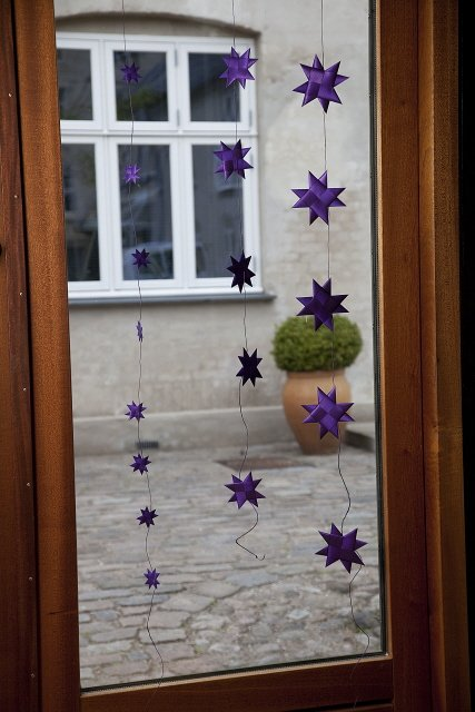 Purple garland with 9 flat folded stars on a purple string S