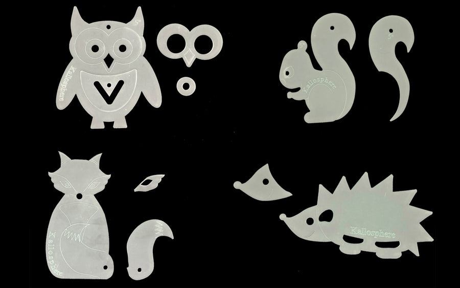 A SET OF FOUR ACRYLIC WOODLAND ANIMAL TEMPLATES
