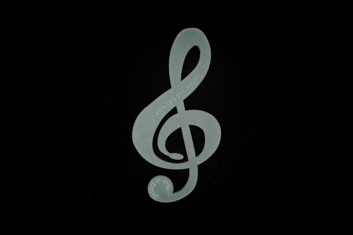 AN ACRYLIC TREBLE CLEF SEWING CRAFT TEMPLATE