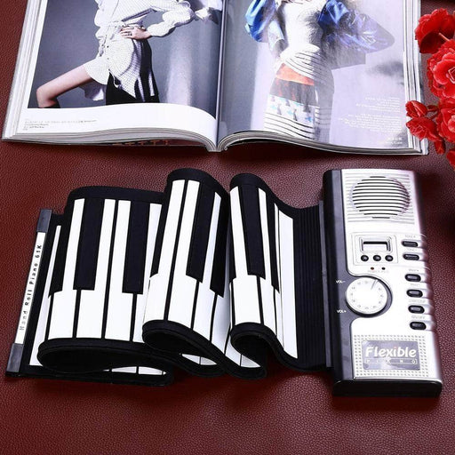 beautiful roll up piano on desk