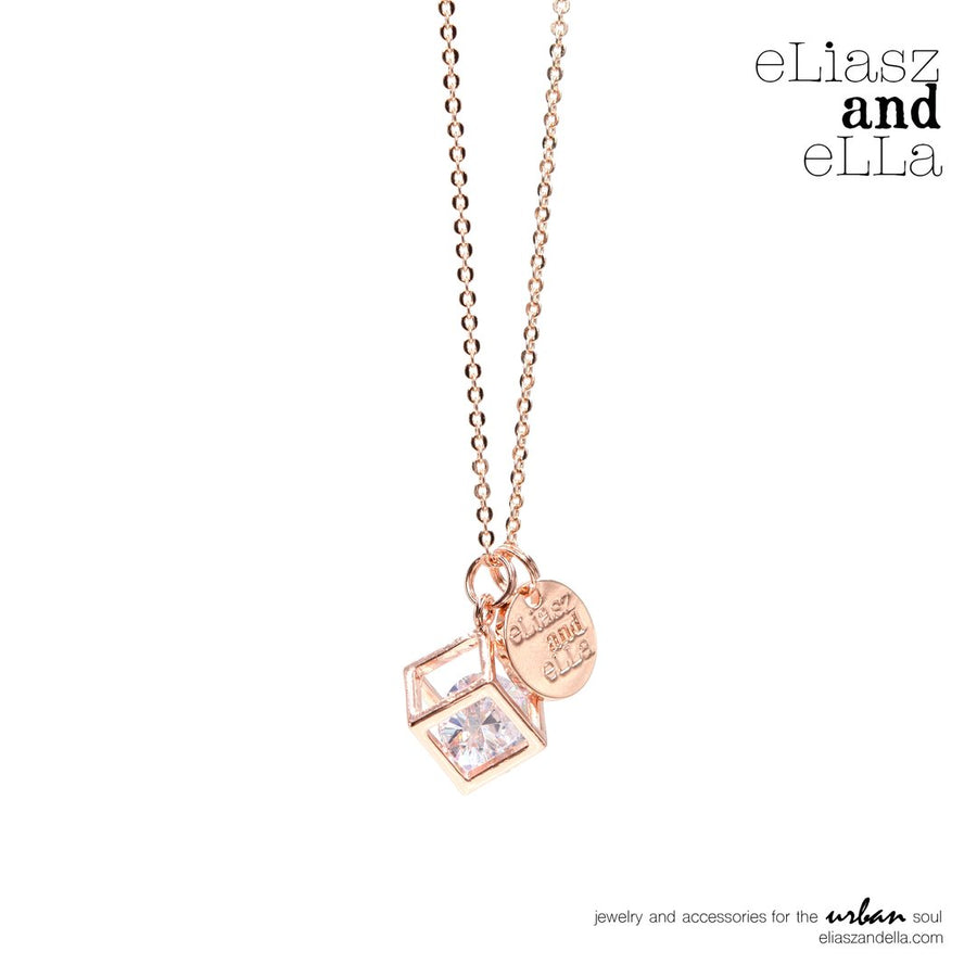 """Caged Diamond"" in rose gold necklace"