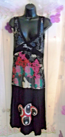 Lovely sleeveless Desiqual dress. Size 10-12.knee length.plunging neckline,jerse