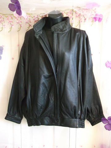 Black leather bomber/batwing sleeve style jacket,elasticated waist,zip front.siz
