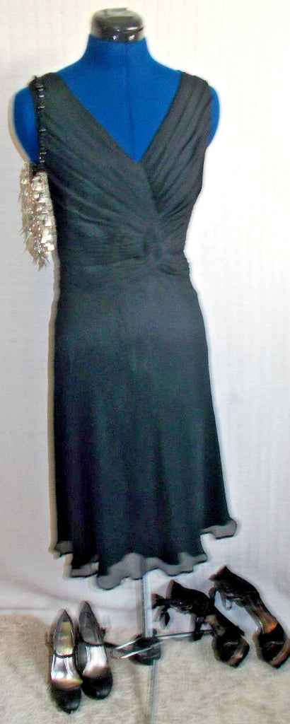 black Teatro occasion dress.size 8, lined, ruffled waist, floaty skirt sleeveles