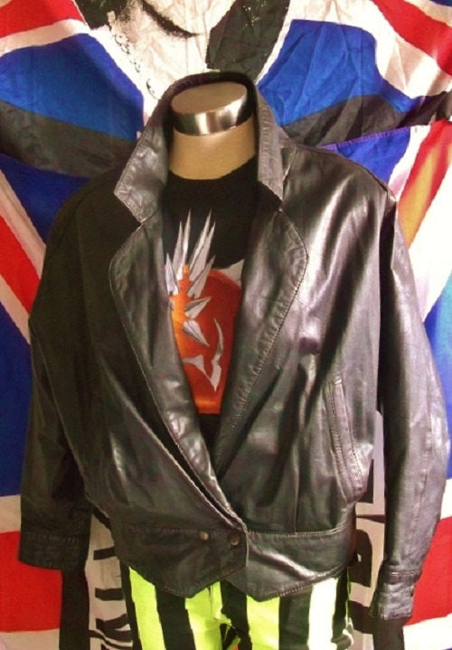 retro crop black leather jacket.size 12.X-over, 2stud waist button