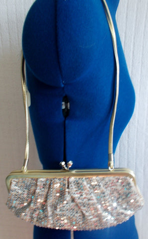 Fab gift item, or party accessory-True Vintage-gold sequinned clutch bag with gold clasp. silk lined.