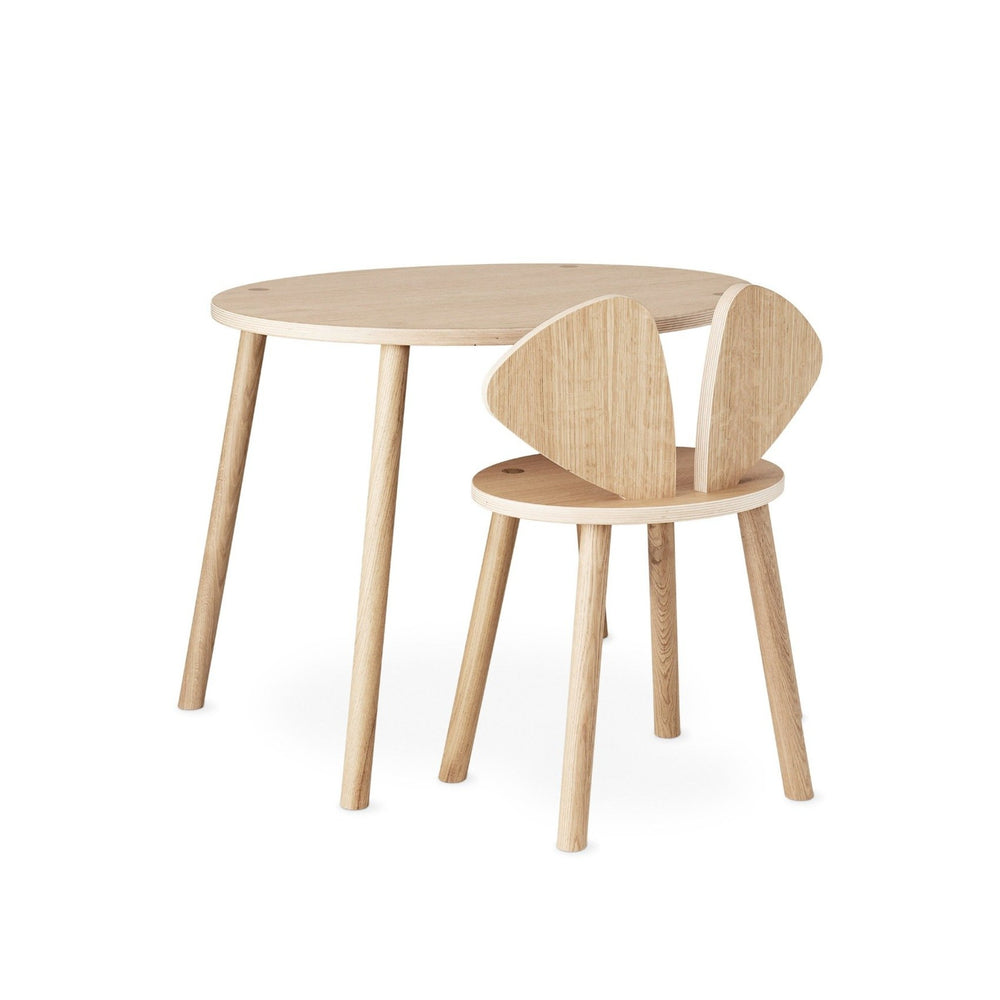 A table and a chair both in wood, oval and round shapes