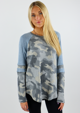 grey and blue camouflage long sleeve top with stripe on sleeve
