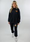 Black Distressed Soft Cozy Comfy Thin Lightweight Stone Washed Jogger Style High Rise Sweatpants Sweat Pants with Drawstring Waist and Orange and Yellow Ombre Boys Lie Logo Symbol on Bottom Left Side on the Back and Graphic on Front with an Angel Surrounded by Fire and Shadow of the Devil in the Background with Quote Prisoner of Love on Top of Graphic and Lightening Bolts