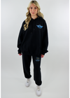 Black Distressed Soft Cozy Comfy Thin Lightweight Stone Washed Jogger Style High Rise Sweatpant Sweat Pant with Drawstring Waist with Blue Ombre Boys Lie Logo Symbol on Back Bottom Left Side and Graphic on Front with a Women Surrounded by Skulls and Light Blue Heart with Quote We All Eat Lies on Top and Quote When Our Hearts are Hungry on Bottom