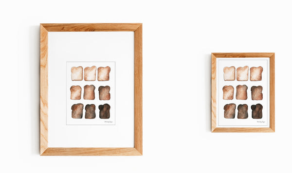 Two framed and matted illustrations of toast